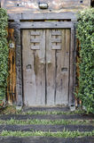 Brown ancient ruined wooden door Stock Images