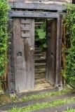 Brown ancient ruined wooden door Royalty Free Stock Image