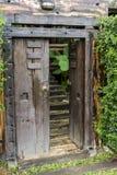 Brown ancient ruined wooden door Stock Photography