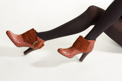 Brown ankle boots with insets. Stock Image