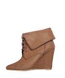 Brown ankle women boot on a white background Stock Image