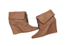 Brown ankle women boots on a white background Royalty Free Stock Images
