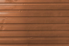 Brown anodized brass. Brown shiny anodized corrugated brass as background Royalty Free Stock Image