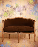 Brown antigue sofa in the room. With colored background Stock Photos