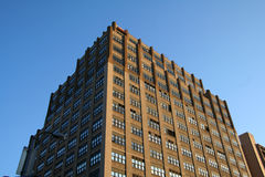 Brown Apartment Building. New York Building royalty free stock photos