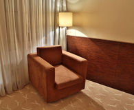 Brown armchair and floor lamp Royalty Free Stock Image