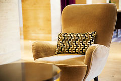 Brown armchair in a lobby in a hotel Stock Image