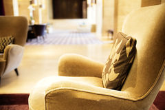 Brown armchair in a lobby in a hotel Royalty Free Stock Photo