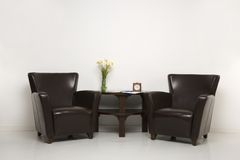 Brown armchairs and table Stock Photo