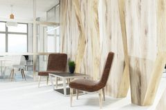 Brown armchairs waiting area, wood, closeup Stock Images