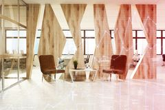 Brown armchairs waiting area, wood toned Royalty Free Stock Image