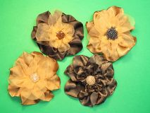 Brown artificial fabric flowers Royalty Free Stock Images