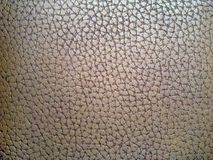 Brown artificial leather texture. Brown texture of a piece of artificial leather Royalty Free Stock Photo