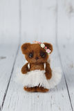 Brown artist teddy bear in dress one of kind Royalty Free Stock Photography