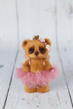 Brown artist teddy bear in pink dress one of kind Royalty Free Stock Photos