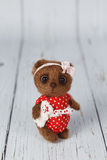 Brown artist teddy bear in red dress one of kind Royalty Free Stock Image