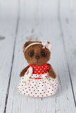 Brown artist teddy bear in red dress one of kind Stock Photography
