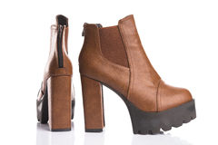 Brown autumn boots with chunky heels Royalty Free Stock Photography