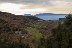 The brown of the Autumn mixes with the green of the valley.  Stock Images