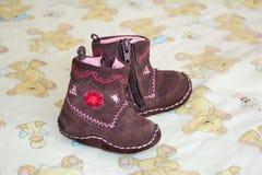 Brown baby booties Stock Photos