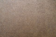 Brown backdrop from fiberboard, hardboard texture with pattern of embossing stock photography