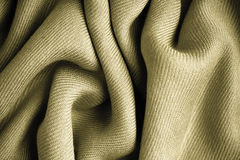 Brown background abstract cloth wavy folds of textile texture Royalty Free Stock Photos