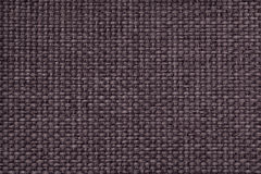 Brown background with braided checkered pattern, closeup. Texture of the weaving fabric, macro. Stock Photography