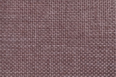 Brown background with braided checkered pattern, closeup. Texture of the weaving fabric, macro. Royalty Free Stock Image