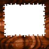 Brown background burning puzzle frame Stock Images