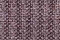Brown background with checkered pattern, closeup. Structure of the fabric macro. Stock Image