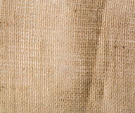 Brown background crumpled and rough burlap. Royalty Free Stock Images