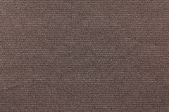 Brown background of fabric grained texture Royalty Free Stock Image