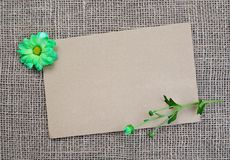 Brown background with flowers and copy space. Blank page for design with sack texture. Gift card. Empty vintage postcard on sacking cloth Stock Photo