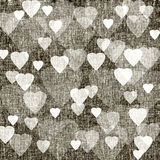 Brown background with hearts, linen texture Royalty Free Stock Images