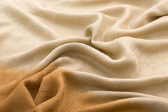 Brown background luxury cloth or wavy folds of grunge silk texture satin velvet. Abstract background luxury cloth or liquid wave or wavy folds of grunge silk Stock Photography