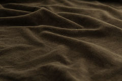 Brown background luxury cloth or wavy folds of grunge silk texture satin velvet. Abstract background luxury cloth or liquid wave or wavy folds of grunge silk Royalty Free Stock Image