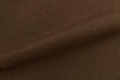 Brown background luxury cloth or wavy folds of grunge silk texture satin velvet Stock Image