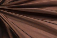 Brown background luxury cloth or wavy folds of grunge silk texture satin velvet Royalty Free Stock Photos