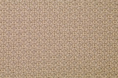 Brown background with regular pattern. Brown faded textile background with thin pattern of circles Royalty Free Stock Photo