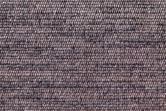 Brown background from soft textile material. Fabric with natural texture. Royalty Free Stock Photography