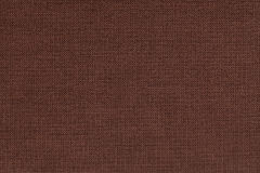 Brown background from a textile material with wicker pattern, closeup. Stock Photo