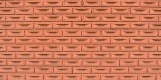 Brown-Backsteinmauer des Nachbarschaftshauses Stockfotos