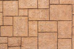 Brown-Backsteinmauer von verschiedenen Größen Stockbild