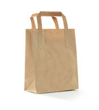 Brown Bag. Studio photograph of a small brown bag against a white background with soft shadows. Copy space royalty free stock photography