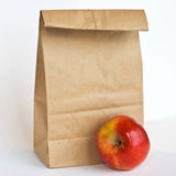 Brown Bag and Gala Apple Stock Image