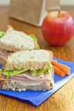 Brown bag lunch. Homemade sandwich with carrot sticks and apple, less expensive than eating out stock image