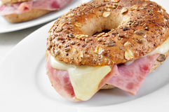 Brown bagel filled with ham and cheese Royalty Free Stock Image