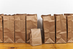 Brown Bags in a Row Stock Images