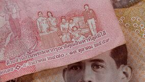 Brown 1000 baht and red 100 baht banknote THB