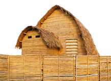Brown bamboo hutsม small nature home isolated. Brown bamboo huts, straw leaves thatched roof, wooden fence around the house, small nature home isolated on Royalty Free Stock Images